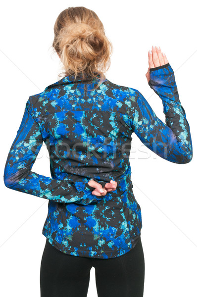 Stock photo: Woman with fingers crossed