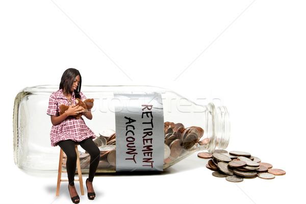 Kobieta w ciąży konto mleka butelki monet Zdjęcia stock © piedmontphoto