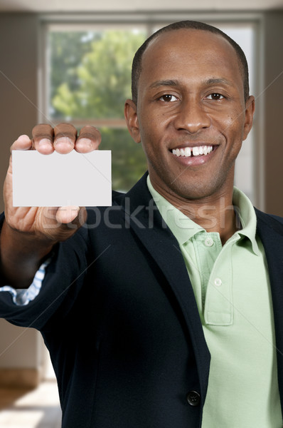 Black Man Holding Business Card Stock photo © piedmontphoto