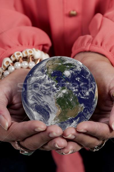 Mulher terra bela mulher palma mãos Foto stock © piedmontphoto