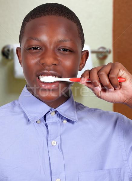 Teenage Boy Brushing Teeth Stock photo © piedmontphoto