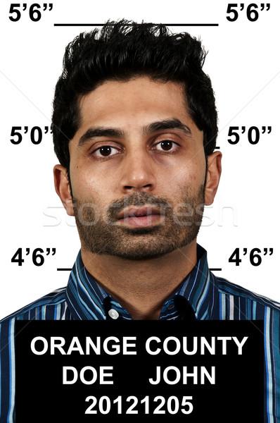 Férfi jóképű fiatalember bűnöző lemez mérleg Stock fotó © piedmontphoto