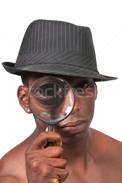 Black Man Looking through a magnifying glass Stock photo © piedmontphoto