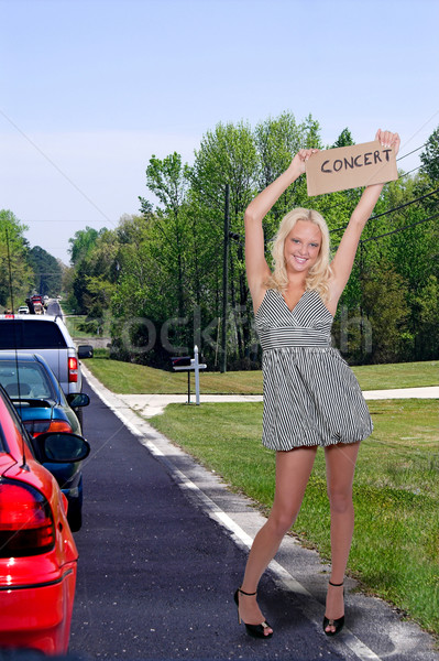 Stock photo: Woman Hitch Hiking to a Concert