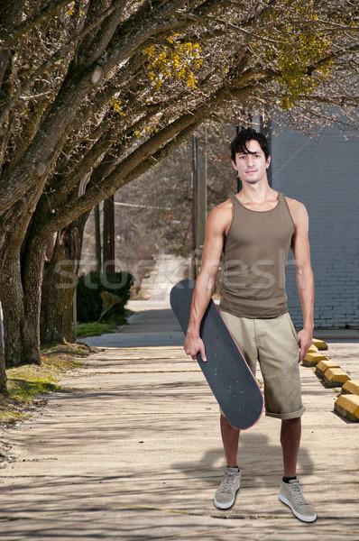 человека скейтборде красивый молодым человеком готовый лет Сток-фото © piedmontphoto