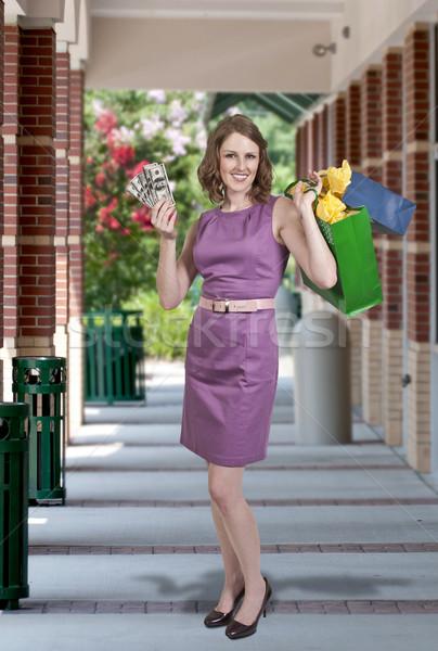 Stock photo: Woman Holding 100 Dollar Bills
