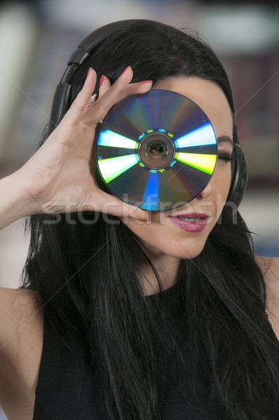 Woman holding CD or DVD Stock photo © piedmontphoto