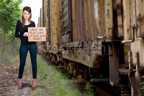 Woman Holding a Sign Stock photo © piedmontphoto