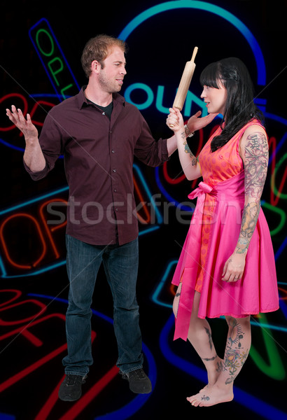 Woman Chasing man with Rolling Pin Stock photo © piedmontphoto