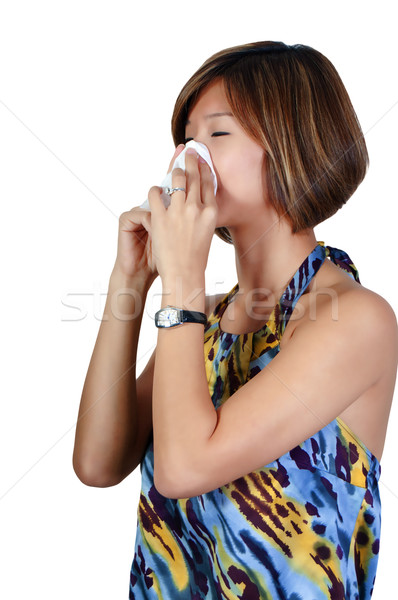 Asian Woman Blowing Nose Stock photo © piedmontphoto