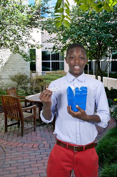 Férfi eszik jóképű tini fekete afroamerikai Stock fotó © piedmontphoto