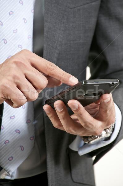 男 ハンサムな男 携帯電話 インターネット 作業 ストックフォト © piedmontphoto