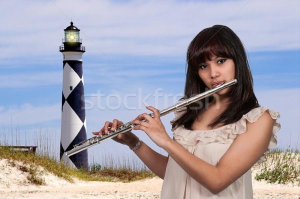 Nő gyönyörű fiatal nő játszik hangszer furulya Stock fotó © piedmontphoto