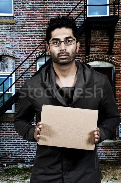 Człowiek młody człowiek papieru Zdjęcia stock © piedmontphoto