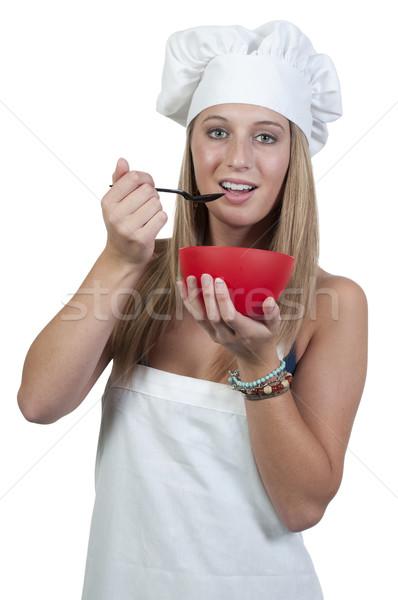 Kobieta jedzenie piękna kobieta kucharz żywności dziewczyna Zdjęcia stock © piedmontphoto
