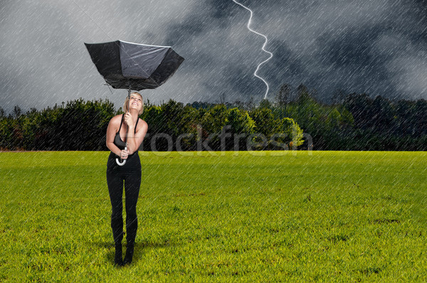 Stock photo: Woman Holding Umbrella