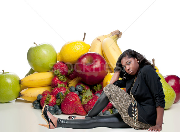 Stock photo: Woman Sitting with Assorted Fruits