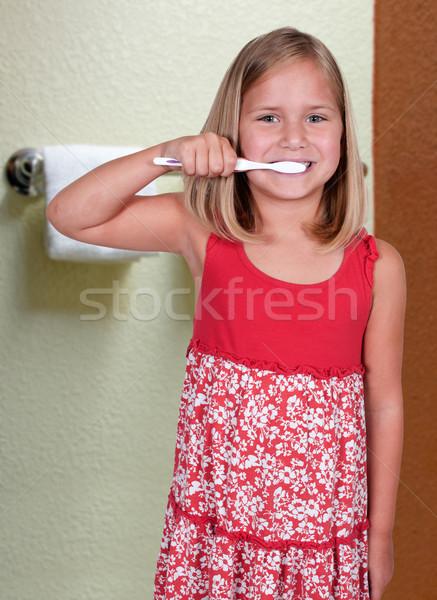 Little Girl Brushing Teeth Stock photo © piedmontphoto
