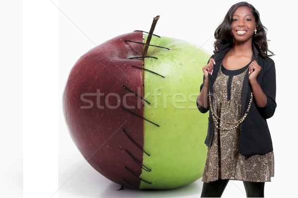 Black teenage girl and a Stitched Apple Stock photo © piedmontphoto