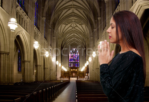 Hispanic Latino woman praying Stock photo © piedmontphoto