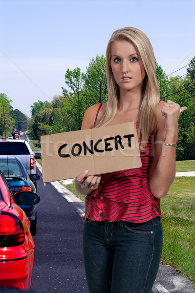 Woman Hitch Hiking to Concert Stock photo © piedmontphoto
