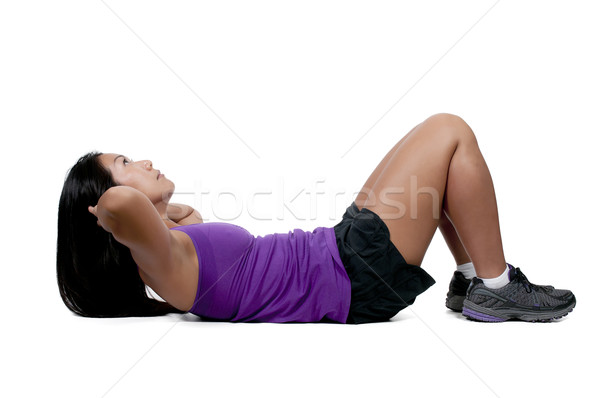 Asian Woman Doing Crunches Stock photo © piedmontphoto