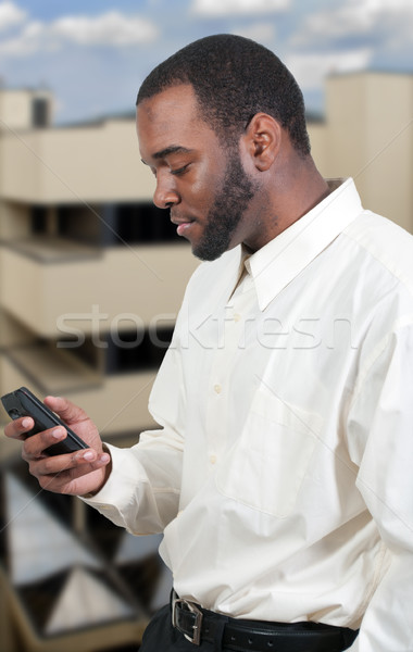 Business Man Texting Stock photo © piedmontphoto