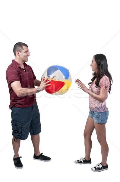 Casal bola de praia jogar mulher praia Foto stock © piedmontphoto