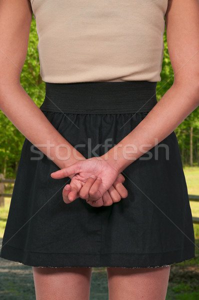 Woman with fingers crossed Stock photo © piedmontphoto