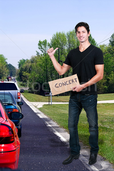 Man Hitch Hiking to a Concert Stock photo © piedmontphoto
