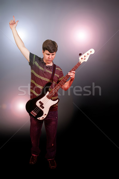 Homme basse guitare jeune homme instrument de musique Photo stock © piedmontphoto