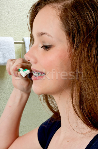 Beautiful Teenage Woman Brushing Teeth Stock photo © piedmontphoto