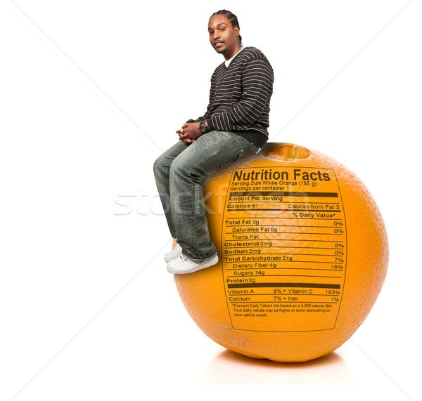 Homem negro laranja nutrição fatos preto africano americano Foto stock © piedmontphoto