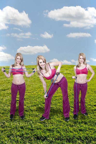 Vrouwen mooie jonge vrouwen weerstand band Stockfoto © piedmontphoto