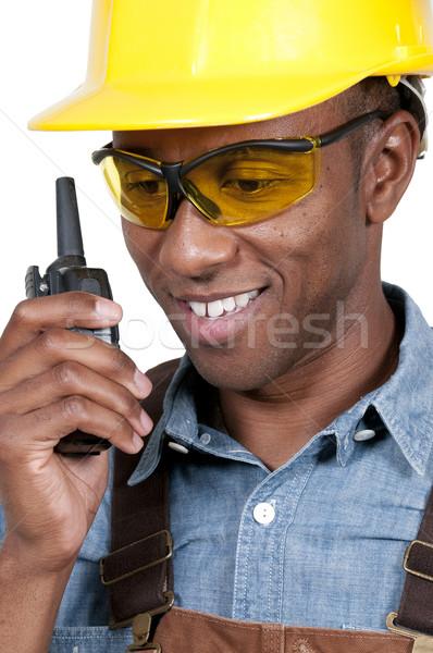 Pracownik budowlany przystojny Murzyn mówić budynku Zdjęcia stock © piedmontphoto