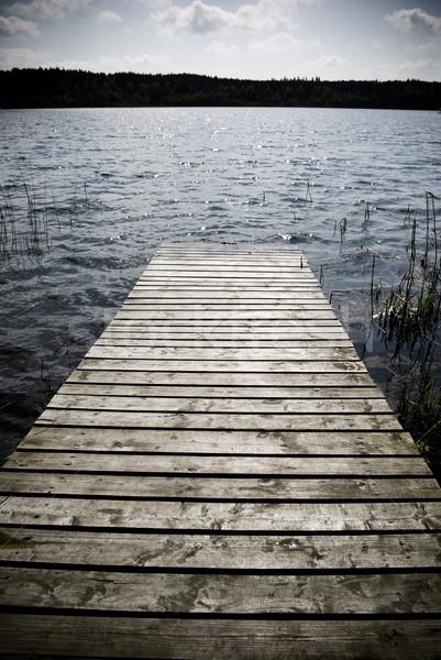 Water verweerde houten pier hemel hout Stockfoto © Pietus