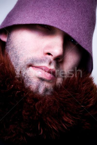 Különc portré fiatalember visel lila kalap Stock fotó © Pietus
