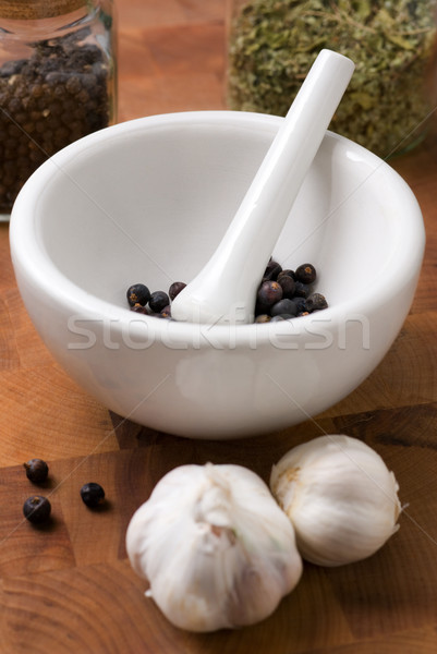 Juniper in mortar and pestle with garlic Stock photo © Pietus