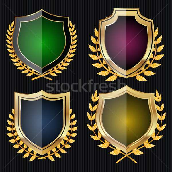 Golden Shield Set With Laurel Wreath. Vector Stock photo © pikepicture