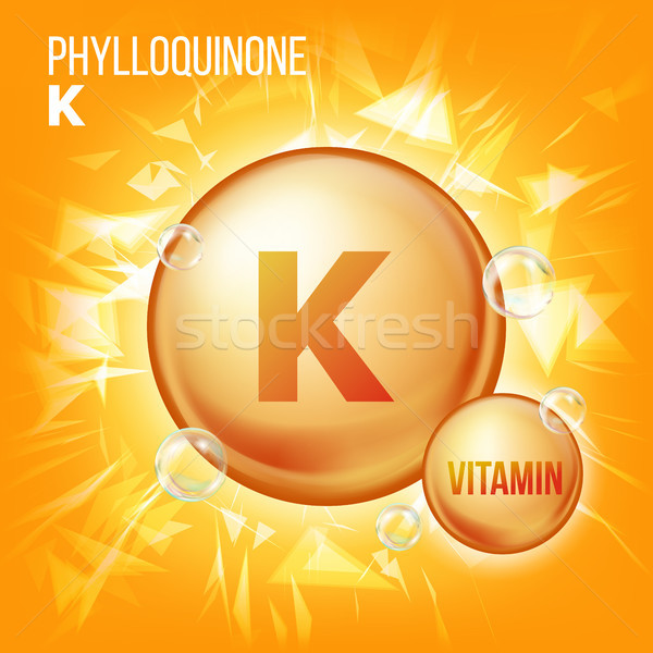 Vitamin K Phylloquinone Vector. Vitamin Gold Oil Pill Icon. Organic Vitamin Gold Pill Icon. For Beau Stock photo © pikepicture