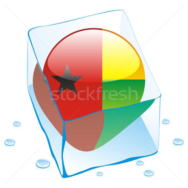 guinea bissau button flag frozen in ice cube Stock photo © PilgrimArtworks