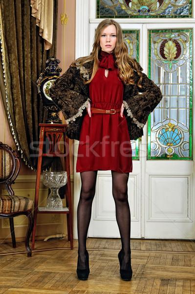 beautiful woman in fur coat. The luxurious antique interior. Stock photo © Pilgrimego