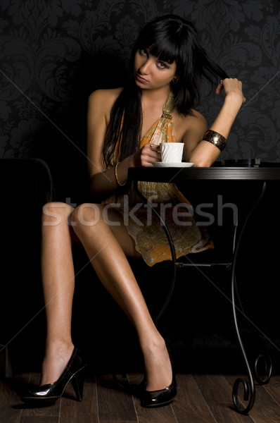 Beautiful girl is sitting in the cafe  Stock photo © Pilgrimego