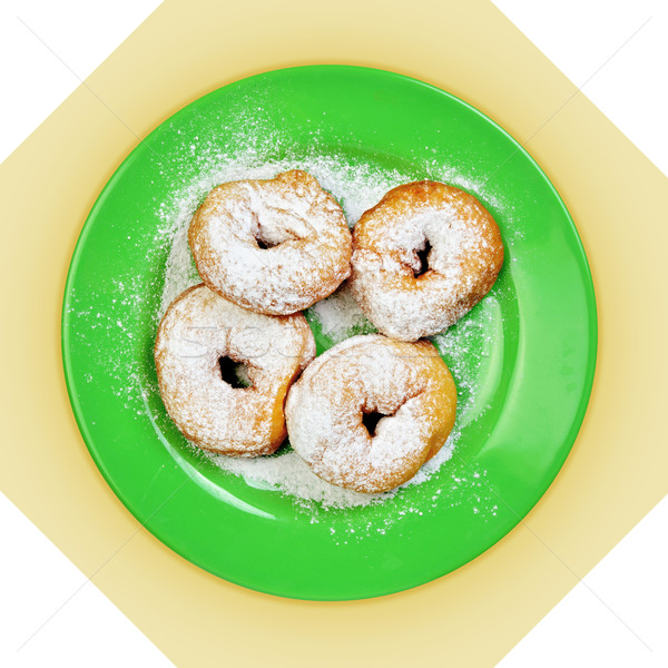 Green dish with donuts, coated with powdered sugar Stock photo © Pilgrimego