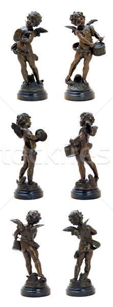 Bronzen antieke beeldje spelen engel geïsoleerd Stockfoto © Pilgrimego