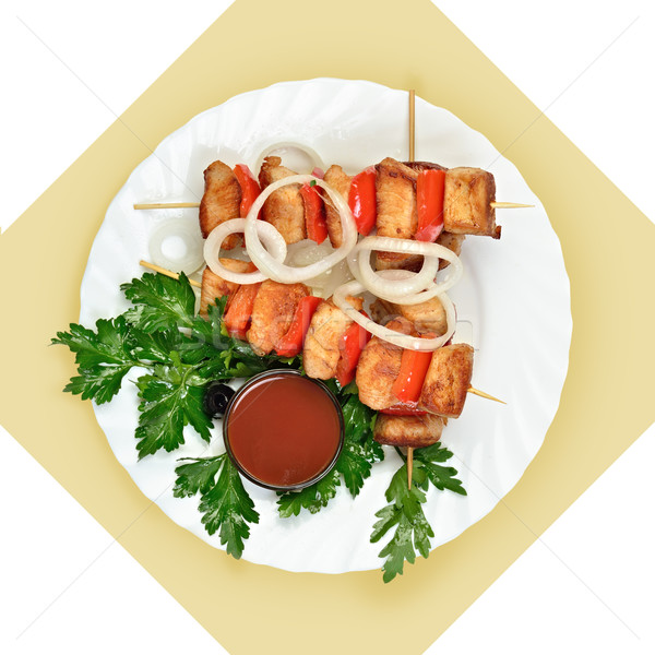 Dish of meat on skewer with tomato sause on white plate. Stock photo © Pilgrimego