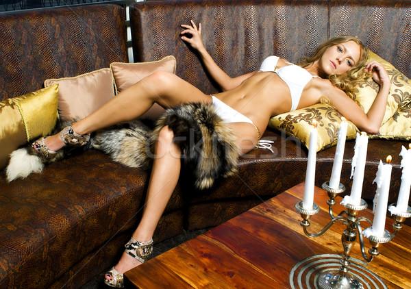 портрет красивая женщина кожа диван счастливым Сток-фото © Pilgrimego
