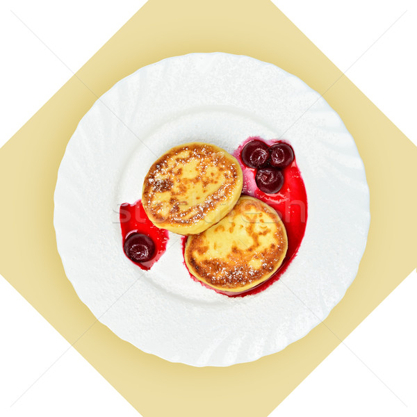 Dish of pancakes with cherry sause on white plate. Stock photo © Pilgrimego