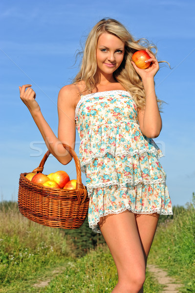 Rural landscape with beautiful blonde walking at the meadow. Stock photo © Pilgrimego