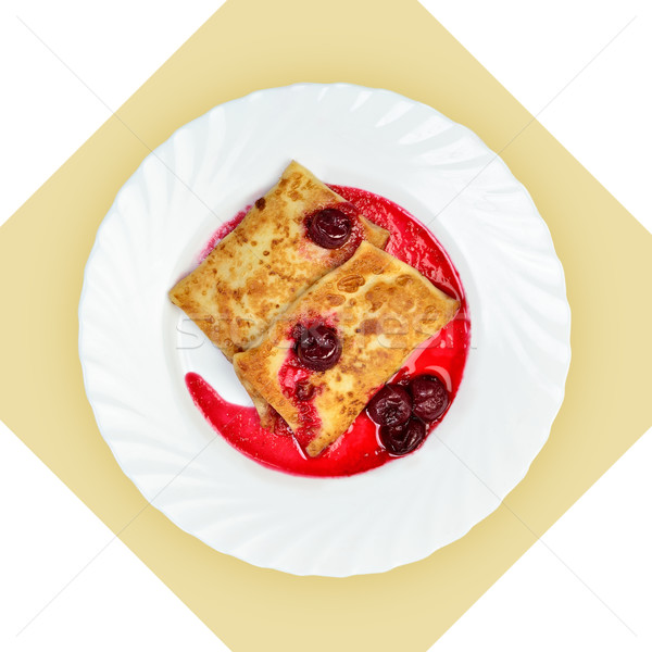 Dish of crepes with cherry sause on white plate. Stock photo © Pilgrimego